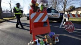 A police roadblock turned into a makeshift memorial in Newtown