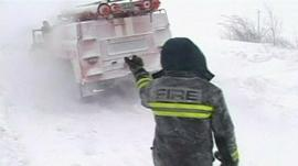 Emergency services helping a vehicle trapped in the snow