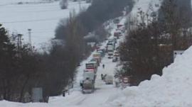 Queue of traffic in snow