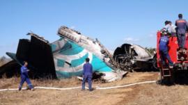 Fire Brigade team gather near the damaged Air Bagan passenger plane in Heho, Burma