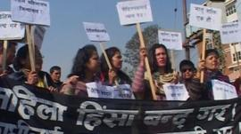 Women holding banners during a protest in Nepal