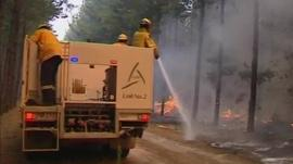 Australian fire fighters tackle blaze