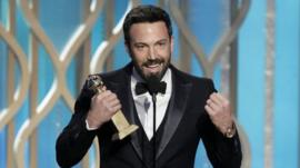 This image released by NBC shows Ben Affleck with his award for best director for