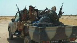 Armed Malian rebels on a truck