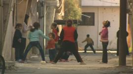 Children play in street in Homs