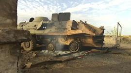 Damaged military vehicle