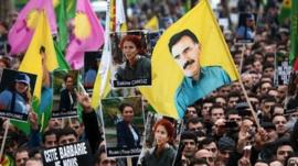 Demonstrators of Kurdish origin gathering with flags displaying PKK (Kurdistan Workers Party) leader Abdullah Ocalan