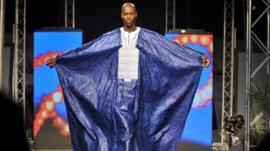 A model presents an outfit by Alphadi during the 10th Dakar Fashion Week, in 2012
