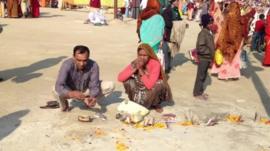 Devotees offering puja