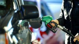 Man using petrol pump