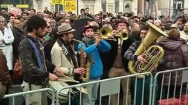A band plays in the middle of the rally