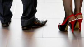 Smart shoes on business man and woman