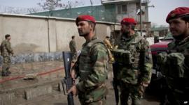 Afghan army soldiers at blast site