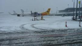 Planes at snow-covered airport