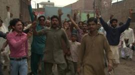 Demonstrators against violence in Lahore