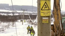 Engineers try to restore island power