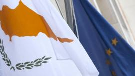 The Cypriot, left, and EU flag