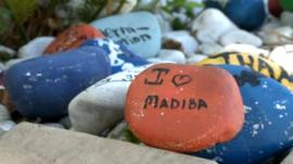 A well-wisher's stone left in front of Mandela's house