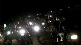 Motorbikes heading to the airstrip