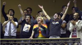 People celebrate in parliament after lawmakers voted to legalise gay marriage in Uruguay