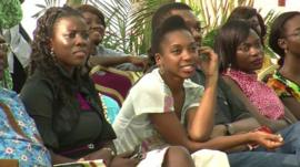 Nigerian theatregoers watching a play outdoors
