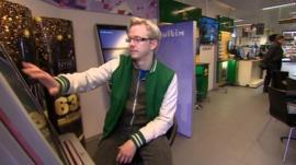 Man on gambling machine