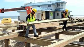 Workers repairing the boardwalk in New Jersey Shore.