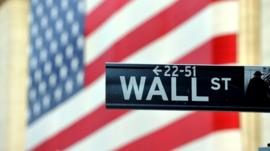 A street sign on Wall St, New York, the financial heart of the city