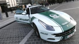 Dubai policewoman and Ferrari patrol car