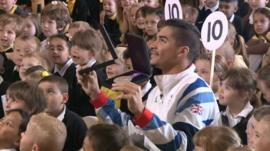 Louis Smith with pupils at Werrington Primary School