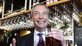 UKIP leader Nigel Farage celebrating in a pub
