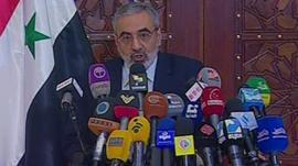 Syria's Information Minister, Omran al-Zoabi