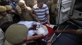 Pakistani prisoner Sanaullah Ranjay is carried on a stretcher