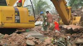 Bodies removed from rubble amid search