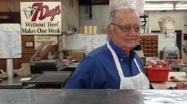 John Kasper in his meat market