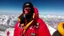 Daniel Hughes at the top of Mount Everest