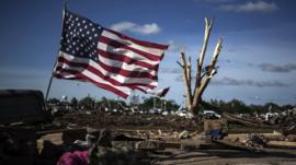 An American flag flies by the devastated town of Moore, Oklahoma
