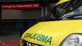 An ambulance outside the entrance to a hospital Accident and Emergency