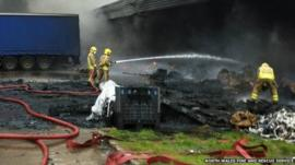 Firefighters at scene of factory fire
