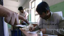 An Afghan registers for a voting card