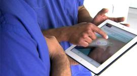 Surgeons with an ipad