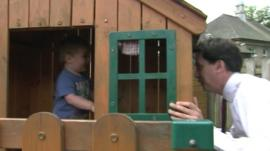 Ed Miliband and a children's playhouse