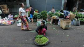 A Burmese vendor sells vegetables at a market in Rangoon