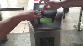 A new electronic card and gate system in a Jakarta train station