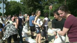 Volunteers with sandbags