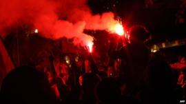 Protesters with flares