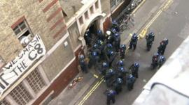 Police officers surround building in Beak Street