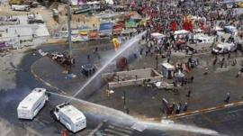 Police use water cannon during protests in Taksim Square in Turkey