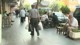 People sit in street in Istanbul