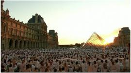 Thousands gather at the Louvre Museum's courtyard.
